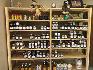 whispering orchards store shelves have jam and pure maple syrup